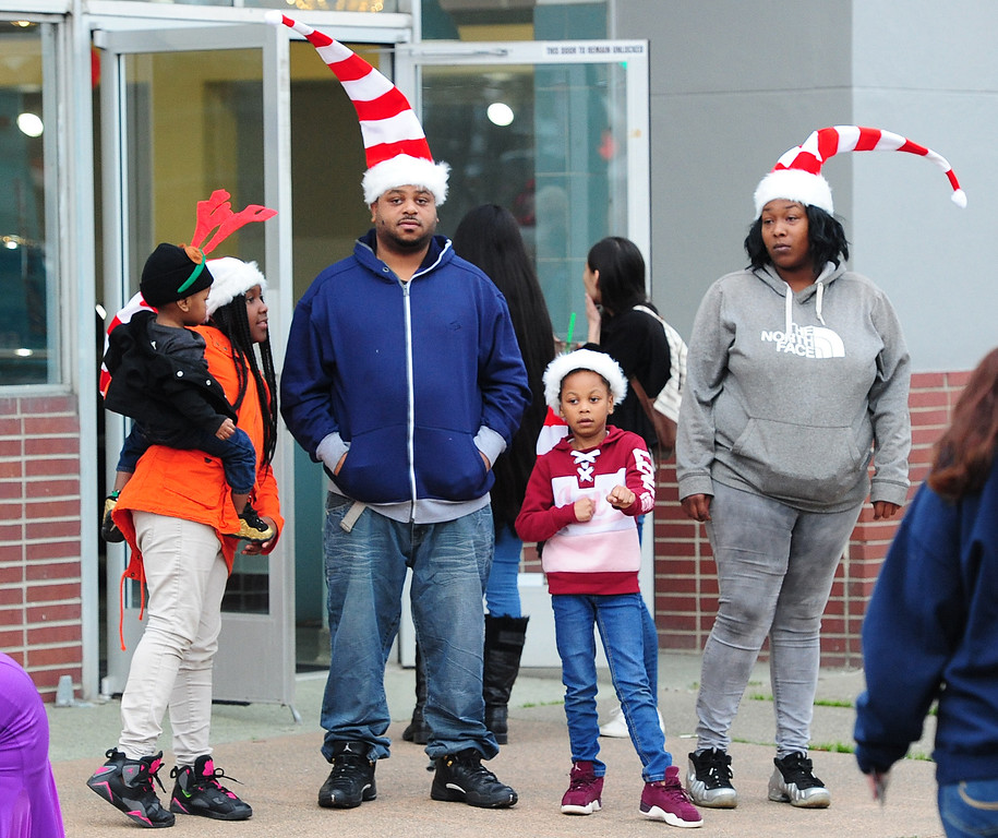. VALLEJO, CA- DEC. 2, A family waits for the start of the Mad Hatter Holiday Parade in downtown Vallejo on Saturday. (CHRIS RILEY/Times-Herald)