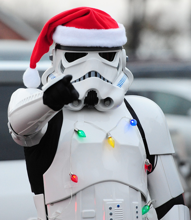 . VALLEJO, CA- DEC. 2, A festively dressed stormtrooper finds the droids he\'s looking for during the Mad Hatter Holiday Parade in downtown Vallejo on Saturday. (CHRIS RILEY/Times-Herald)