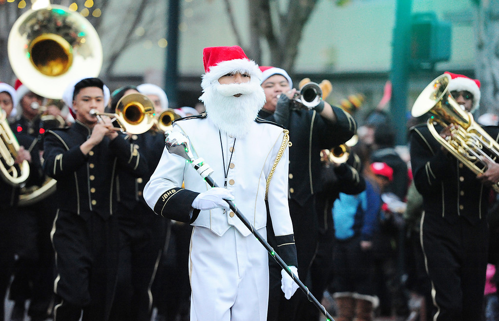 . VALLEJO, CA- DEC. 2, Jared Tating leads the Jesse Bethel Marching Band down Georgia Street during the Mad Hatter Holiday Parade in downtown Vallejo on Saturday. (CHRIS RILEY/Times-Herald)