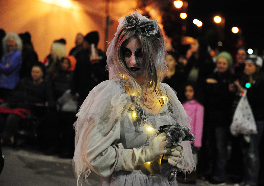 . VALLEJO, CA- DEC. 2, Ghost Bride Marie Dana walks with the group from NightMare Island during the Mad Hatter Holiday Parade in downtown Vallejo on Saturday. (CHRIS RILEY/Times-Herald)