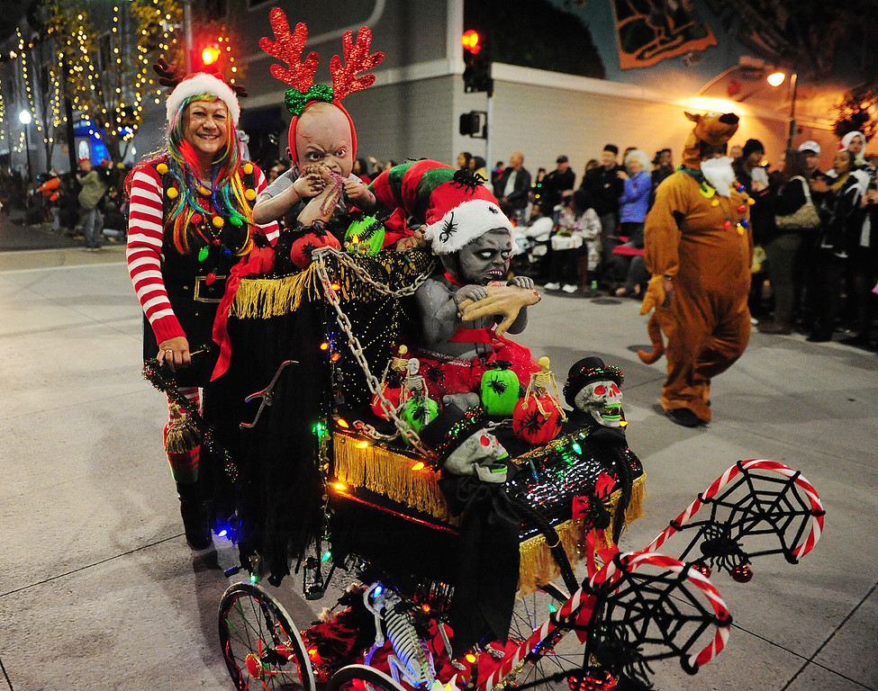 . VALLEJO, CA- DEC. 2, Leonora Jones with the Zombie Baby Carriage walks with the group from NightMare Island during the Mad Hatter Holiday Parade in downtown Vallejo on Saturday. (CHRIS RILEY/Times-Herald)