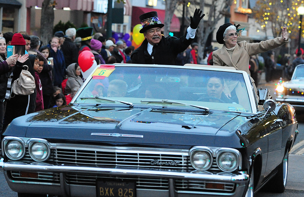 . VALLEJO, CA- DEC. 2, Vallejo mayor Bob Sampayan and his wife Ramona wave to the crowd during the Mad Hatter Holiday Parade in downtown Vallejo on Saturday. (CHRIS RILEY/Times-Herald)