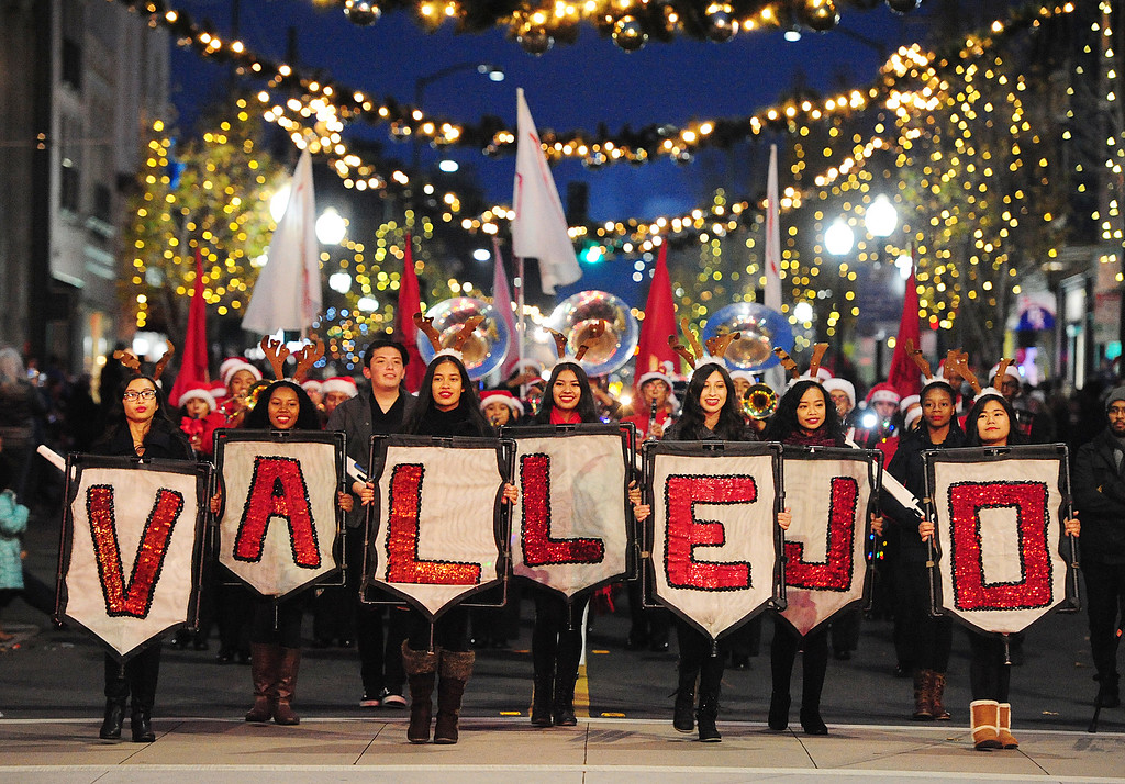 . VALLEJO, CA- DEC. 2, The Vallejo High School Marching band passes down Georgia Street during the Mad Hatter Holiday Parade in downtown Vallejo on Saturday. (CHRIS RILEY/Times-Herald)