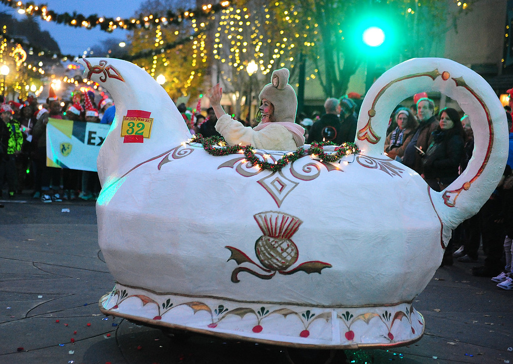. VALLEJO, CA- DEC. 2, Tracy Joy, dressed as the door mouse waves at the crowd during the Mad Hatter Holiday Parade in downtown Vallejo on Saturday. (CHRIS RILEY/Times-Herald)