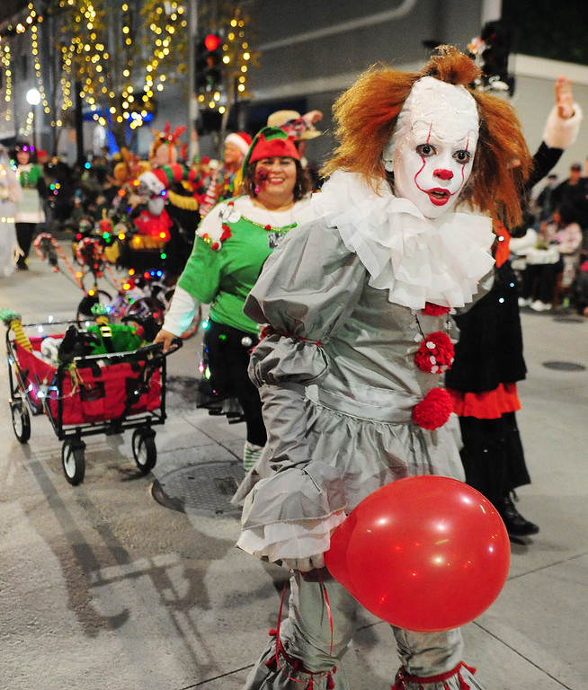 . VALLEJO, CA- DEC. 2, Giovanni Gomez, dressed as Pennywise, walks with the group from NightMare Island during the Mad Hatter Holiday Parade in downtown Vallejo on Saturday. (CHRIS RILEY/Times-Herald)
