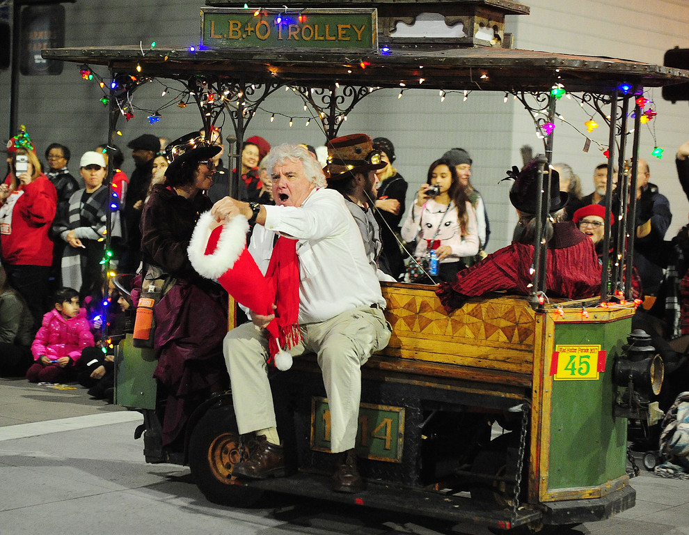 . VALLEJO, CA- DEC. 2, Brian O\'Reilly calls for donations as he rides the L.B.+O Trolley during the Mad Hatter Holiday Parade in downtown Vallejo on Saturday. (CHRIS RILEY/Times-Herald)