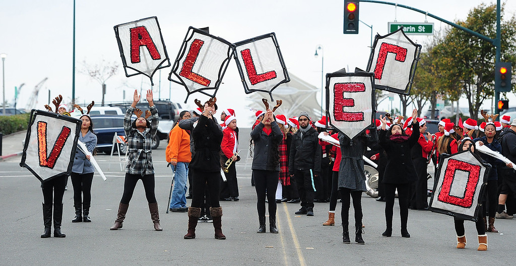 . VALLEJO, CA- DEC. 2, The Vallejo High School color guard practices a throw before the Mad Hatter Holiday Parade in downtown Vallejo on Saturday. (CHRIS RILEY/Times-Herald)