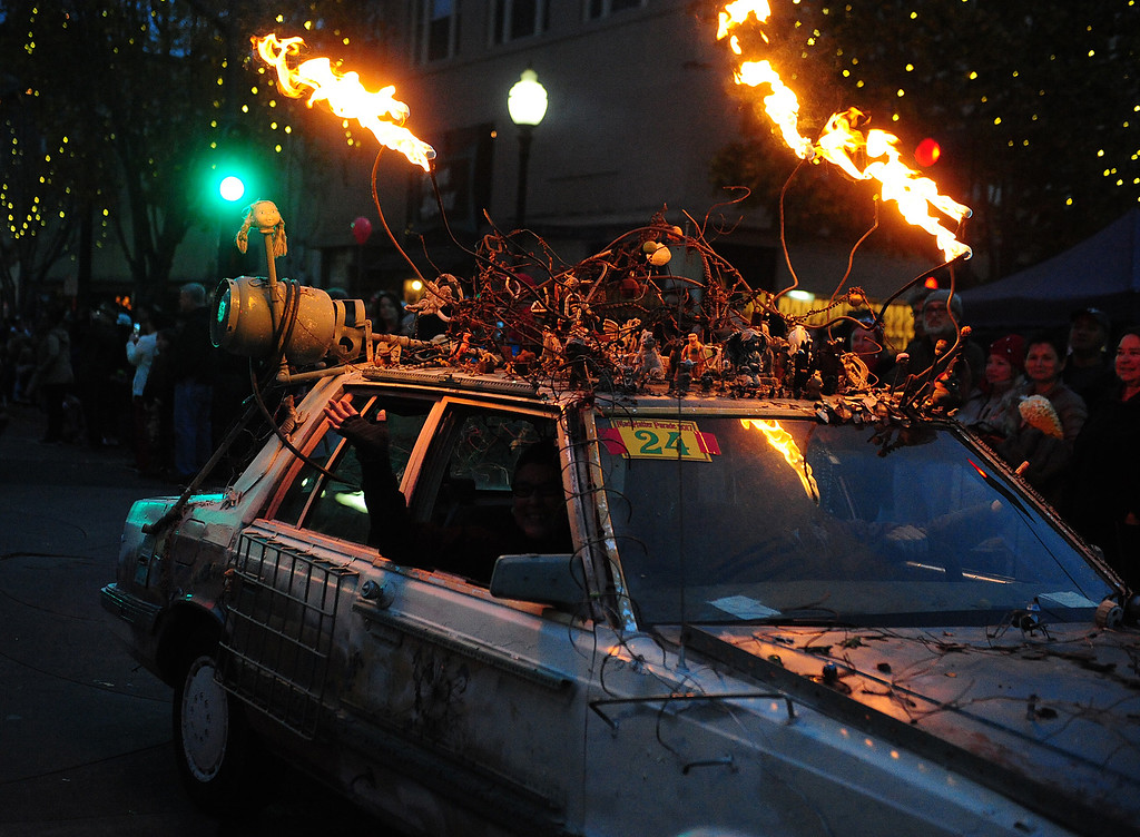 . VALLEJO, CA- DEC. 2, Discordia by Darrick Servis lights up Georgia Street during the Mad Hatter Holiday Parade in downtown Vallejo on Saturday. (CHRIS RILEY/Times-Herald)