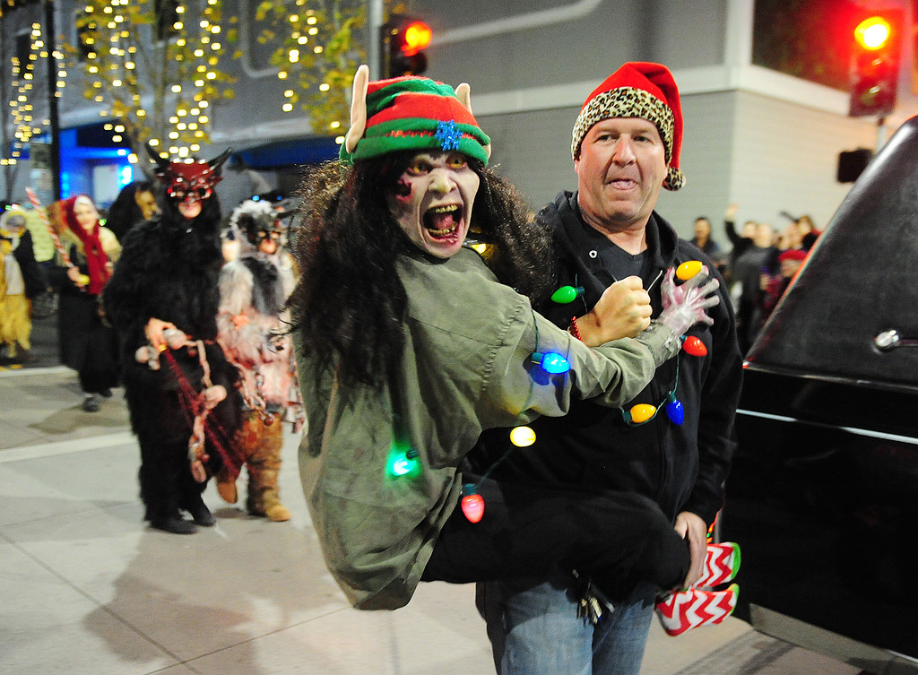 . VALLEJO, CA- DEC. 2, NightMARE Island Mascot \'Sally\' with Jean Paul Fisher walks with the group from NightMare Island during the Mad Hatter Holiday Parade in downtown Vallejo on Saturday. (CHRIS RILEY/Times-Herald)