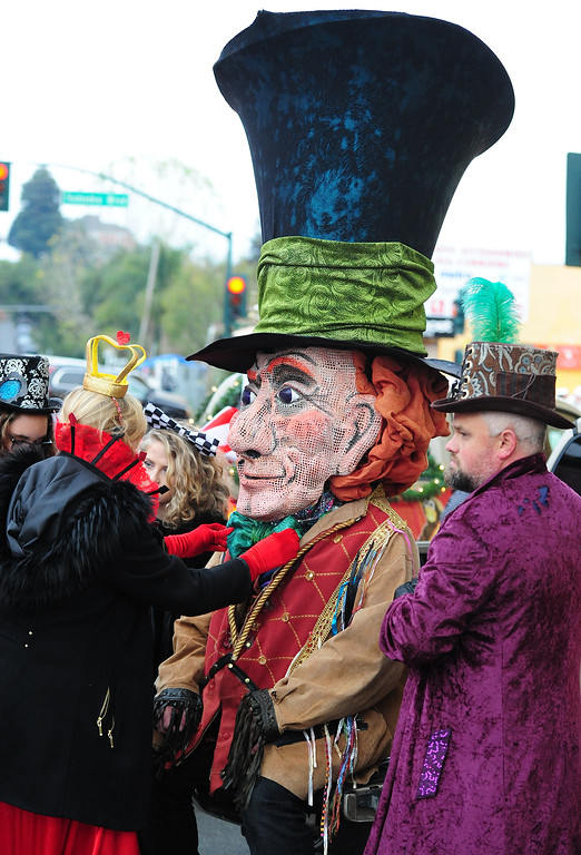 . VALLEJO, CA- DEC. 2, Melissa Hughs, dressed as the Queen of Hearts straightens the Mad Hatter\'s bowtie before the Mad Hatter Holiday Parade in downtown Vallejo on Saturday. (CHRIS RILEY/Times-Herald)