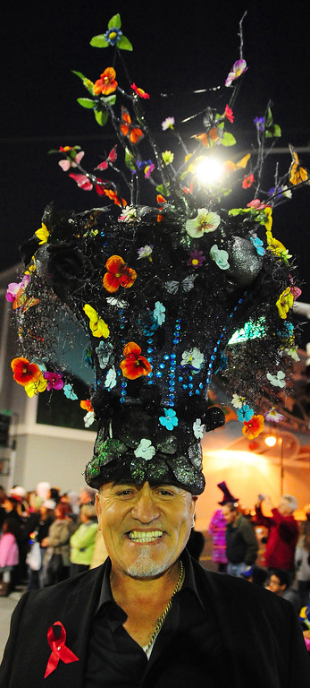 . VALLEJO, CA- DEC. 2, Mario Saucedo dons one of his amazing hats as he walks down Georgia Street during the Mad Hatter Holiday Parade in downtown Vallejo on Saturday. (CHRIS RILEY/Times-Herald)