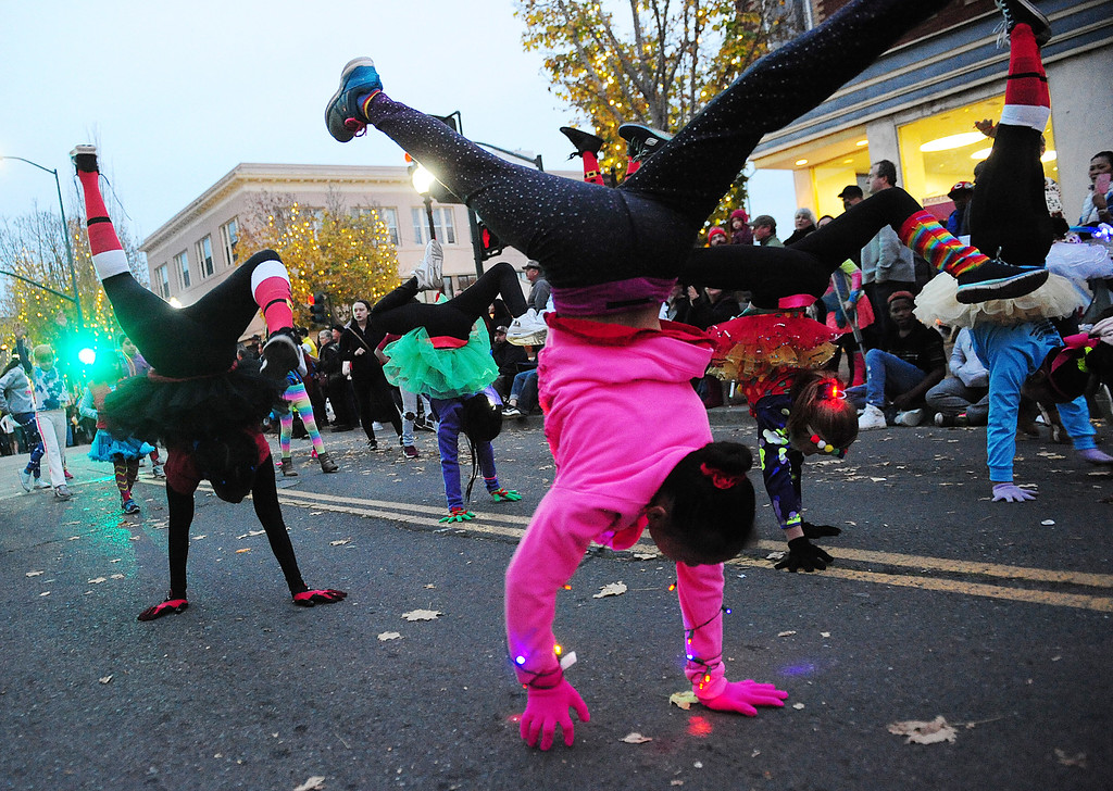 . VALLEJO, CA- DEC. 2, Athletes with the North Bay Athletic Association walk on their hands during the Mad Hatter Holiday Parade in downtown Vallejo on Saturday. (CHRIS RILEY/Times-Herald)