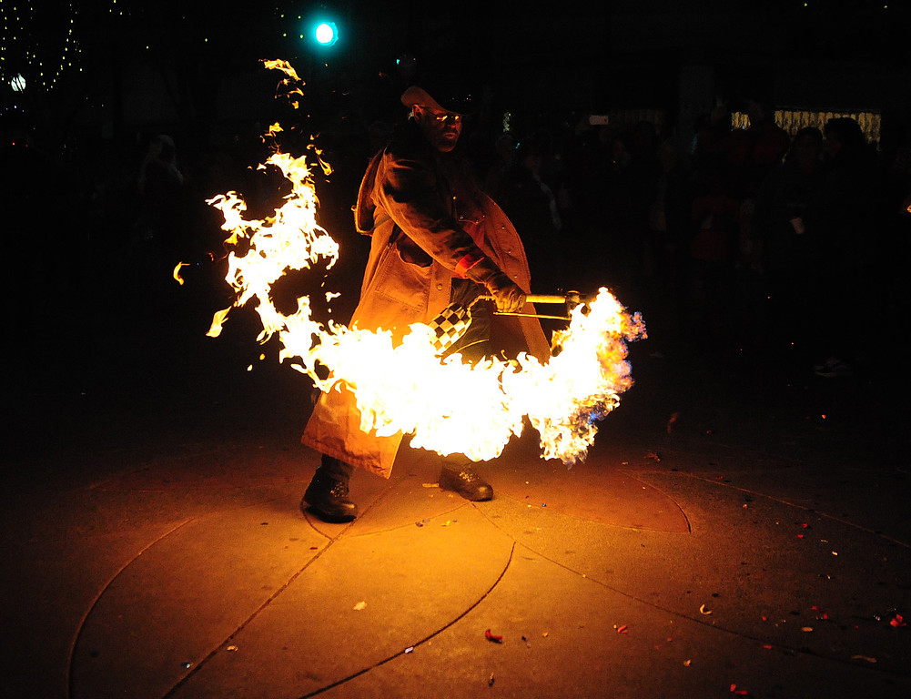 . VALLEJO, CA- DEC. 2, Andy Pischalnikoff shoots a fireball into the street during the Mad Hatter Holiday Parade in downtown Vallejo on Saturday. (CHRIS RILEY/Times-Herald)