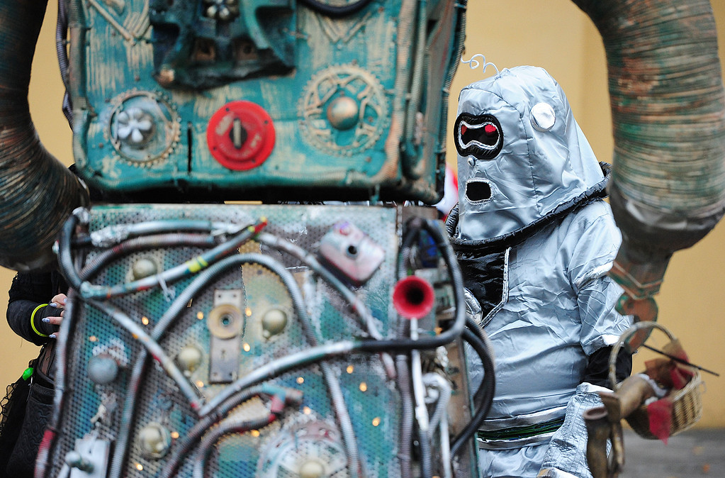 . VALLEJO, CA- DEC. 2, Lex Sinclair prepares to walk with a creation called \'Robot\' in the Mad Hatter Holiday Parade in downtown Vallejo on Saturday. (CHRIS RILEY/Times-Herald)
