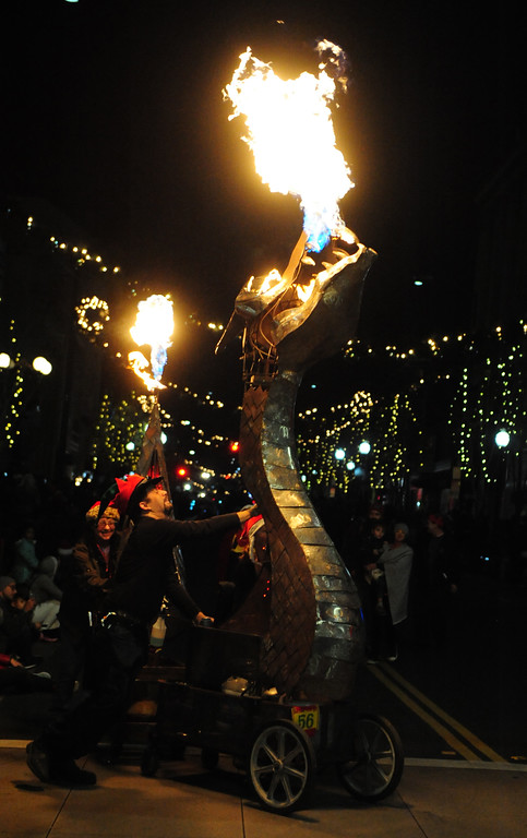 . VALLEJO, CA- DEC. 2, The Dragon Cart spews fire during the Mad Hatter Holiday parade in downtown Vallejo on Saturday.  (CHRIS RILEY/Times-Herald)