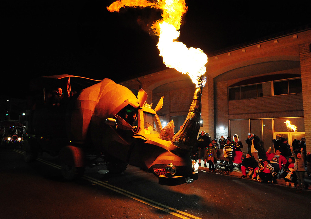 . VALLEJO, CA- DEC. 2, The Rhino Redemption art car by Kevin Clark spews fire out of its horn as it passes down Georgia Street to end the Mad Hatter Holiday Parade on Saturday in downtown Vallejo. (CHRIS RILEY/Times-Herald)