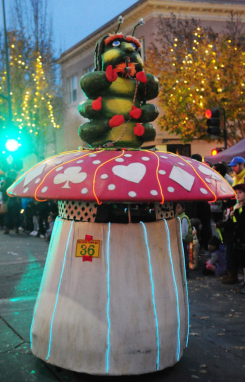 . VALLEJO, CA- DEC. 2, A hookah smoking caterpillar rides a mushroom down Georgia Street during the Mad Hatter Holiday Parade in downtown Vallejo on Saturday. (CHRIS RILEY/Times-Herald)