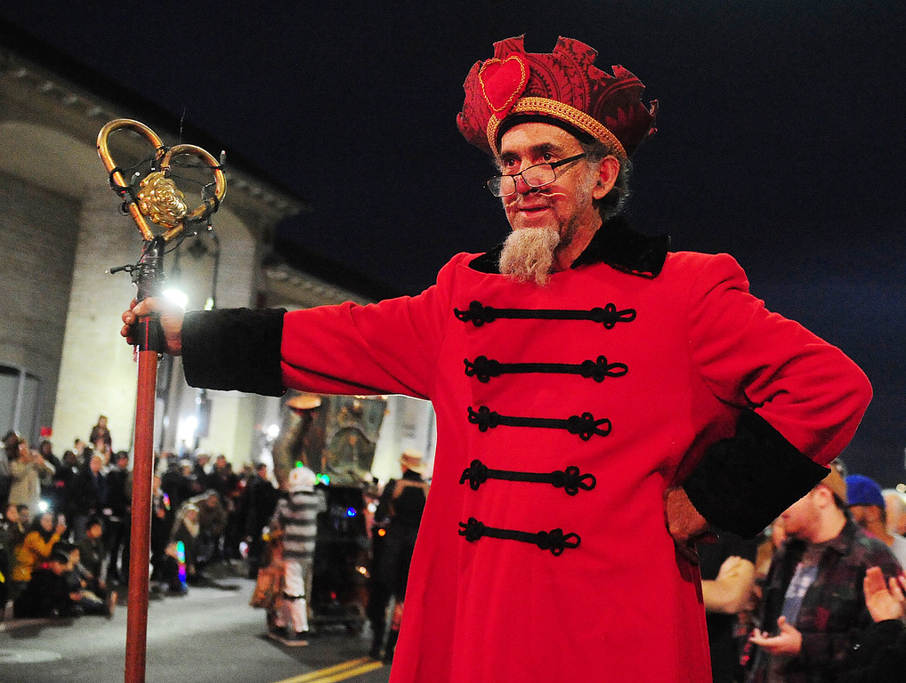 . VALLEJO, CA- DEC. 2, Parade Grand Poobah Shannon O\'Hare  watches as entries in the Mad Hatter Holiday Parade pass through downtown Vallejo on Saturday. (CHRIS RILEY/Times-Herald)