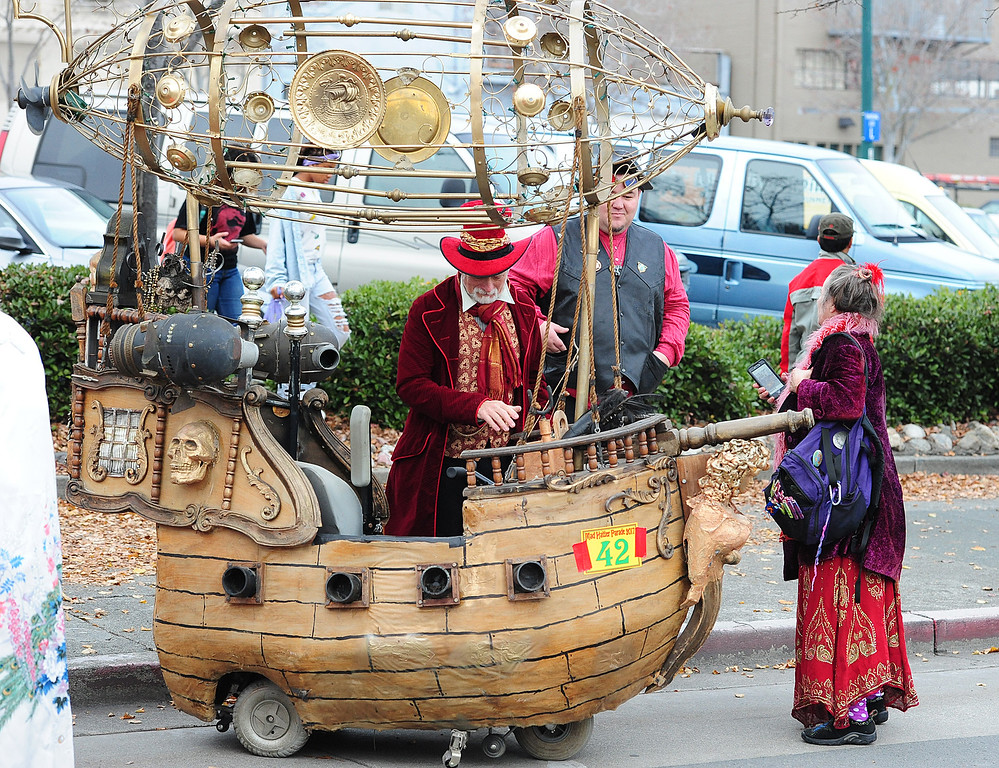 . VALLEJO, CA- DEC. 2, People in costume check out the pirate airship created by Obtainium Works before Mad Hatter Holiday Parade in downtown Vallejo on Saturday. (CHRIS RILEY/Times-Herald)