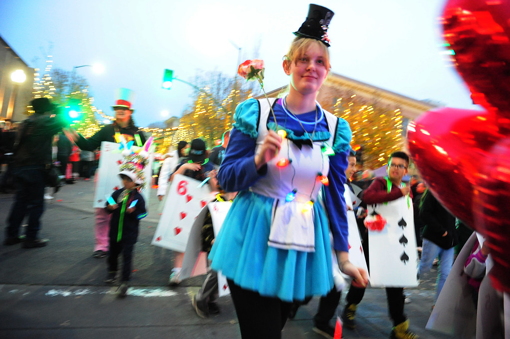 . VALLEJO, CA- DEC. 2, Members of the Girl and Boy Scouts walk in the Mad Hatter Holiday Parade in downtown Vallejo on Saturday. (CHRIS RILEY/Times-Herald)