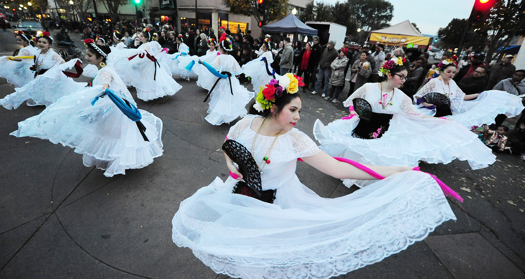 . VALLEJO, CA- DEC. 2, Paloma Rojas performs with Ballet Folklorico during the Mad Hatter Holiday Parade in downtown Vallejo on Saturday. (CHRIS RILEY/Times-Herald)