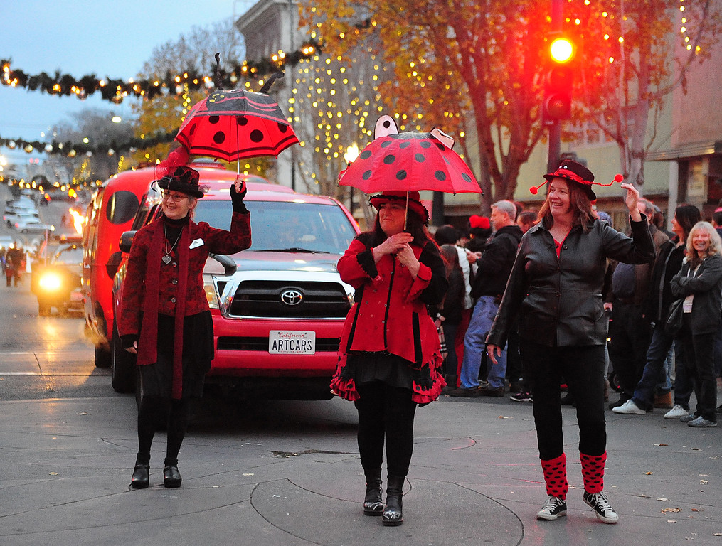 . VALLEJO, CA- DEC. 2, Sherry Tobin, center walks with Anne Gelhaus, right, and Katy Meissner and the Lady Bug art car during the Mad Hatter Holiday Parade in downtown Vallejo on Saturday. (CHRIS RILEY/Times-Herald)