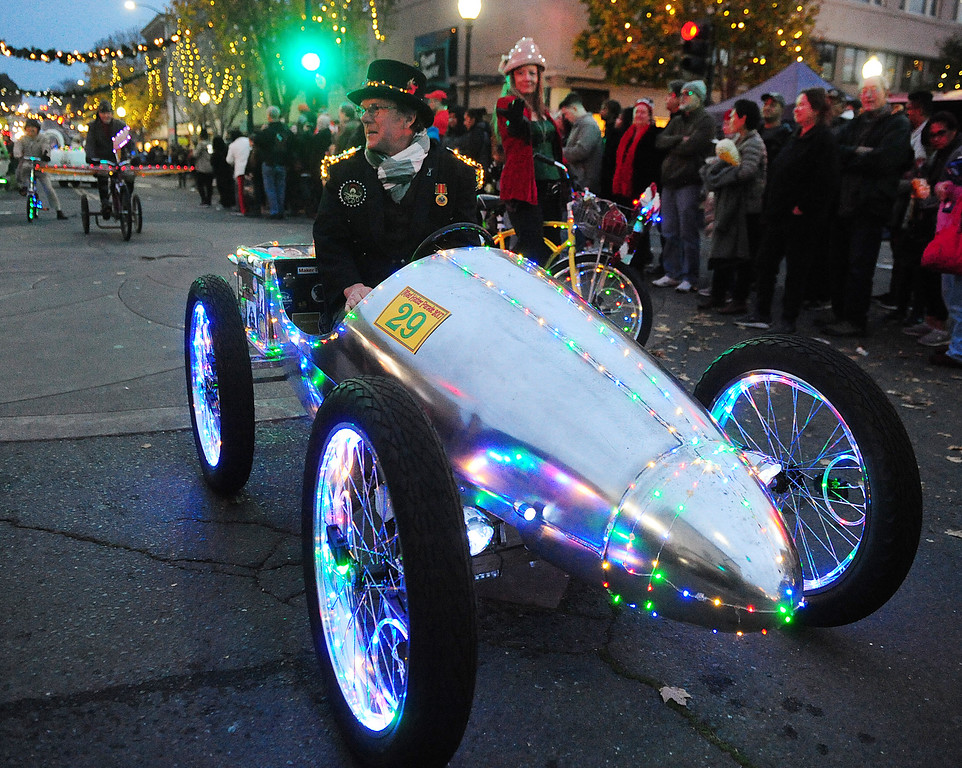 . VALLEJO, CA- DEC. 2, Rusty Cleaver peddles his kinetic vehicle down Georgia Street during the Mad Hatter Holiday Parade in downtown Vallejo on Saturday. (CHRIS RILEY/Times-Herald)