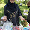 Roger Schneider | The Goshen News<br /> Huda Mashhour of Goshen shows some of the Palestinian food she and her husband Khalaf were offering at the Goshen Multicultural Festival Saturday at Rogers Park.