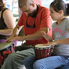 Roger Schneider | The Goshen News<br /> Miguel Garcia and his daughter  Lil Garcia-Bayles, 11, Goshen, join in the mulitcultural drumming event Saturday at the Goshen Multicultural Festival at Rogers Park.
