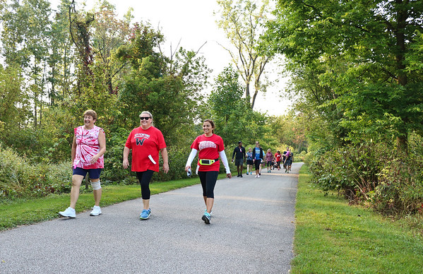 LEANDRA BEABOUT | THE GOSHEN NEWS<br /> Joy St. Germain, Jamie Olcese and Marisa Klopfenstein participate in the Maple City Walk.