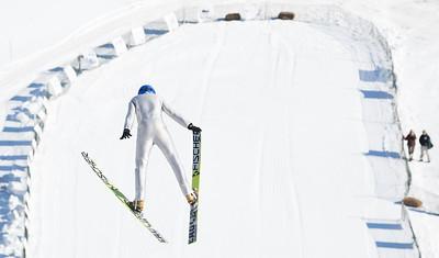 DA029,DJ,Soaring high over snow, ski jumpers compete for distance