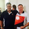Left, Micky Ward Charities President Rick Dupuis of Hudson, N.H., with the legendary boxer himself, who is holding a painting made special by a young girl age named Bella who painted it her feet!