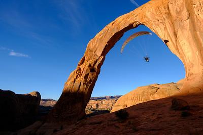 Paraglider through Corona Arch