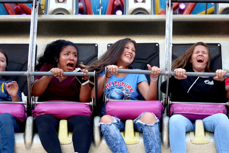 Lily Garza (left), 13, and Trinity Faxon (center), 13, both of Aurora, went to new heights on the rides at Montgomery Fest on Friday. Carnival rides, games and musical performances were featured throughout the weekend, to entertain the crowds in downtown Montgomery.