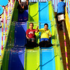 Ivan Leon, 13, and Sebastian Chavez, 13, both of Aurora, went down the slide together at Montgomery Fest on Friday. The carnival and rides were a hit with crowds throughout the three-day event.