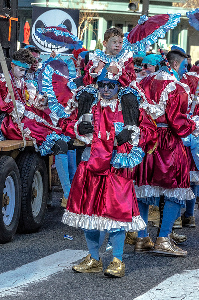 Child on Shoulders, Beer in Hand, Mummers