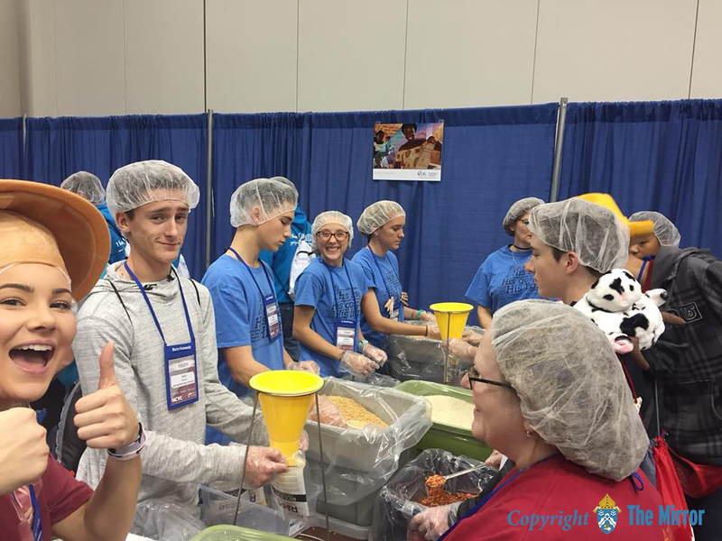 FOOD TO CAMBODIA—​Youth and adult chaperones of St. Peter the Apostle Parish, Joplin, helped package food for the hungry of Cambodia during a service opportunity at NCYC. (<i>The Mirror</i>)