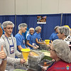 FOOD TO CAMBODIA—Youth and adult chaperones of St. Peter the Apostle Parish, Joplin, helped package food for the hungry of Cambodia during a service opportunity at NCYC. (<i>The Mirror</i>)