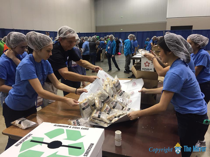 SERVICE PROJECT—​Youth and adults of St. Peter the Apostle Parish, Joplin, helped organize rice, beans, and other items to be packaged and sent for the hungry of Cambodia during a service opportunity at NCYC. (<i>The Mirror</i>)