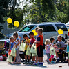 LEANDRA BEABOUT | THE GOSHEN NEWS<br /> Children lined up along Market St. in Nappanee to scramble for candy thrown from the parade floats and trucks.