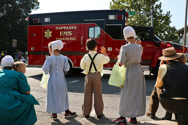 LEANDRA BEABOUT | THE GOSHEN NEWS<br /> Children waved to local paramedics and law enforcement vehicles as they joined the parade, some with sirens blaring.