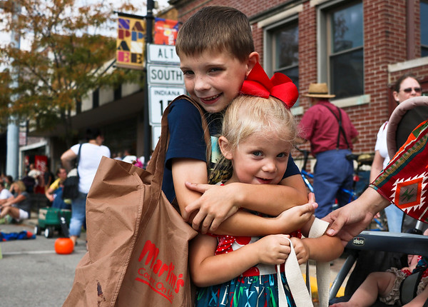 LEANDRA BEABOUT | THE GOSHEN NEWS<br /> Aedan Joselyn, 7, hugs his sister, Adalyn Joslelyn, 3, after filling his bag with candy at the Nappanee Apple Festival. The family lives in Nappanee.
