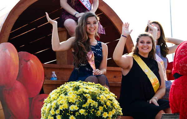 LEANDRA BEABOUT | THE GOSHEN NEWS<br /> The Miss Apple Blossom Queen and her court paraded down Market St. From left: Ireland Hooley, Miss Apple Blossom Queen second runner up, and Taylor McKinley, the Miss Apple Blossom People's Choice winner.