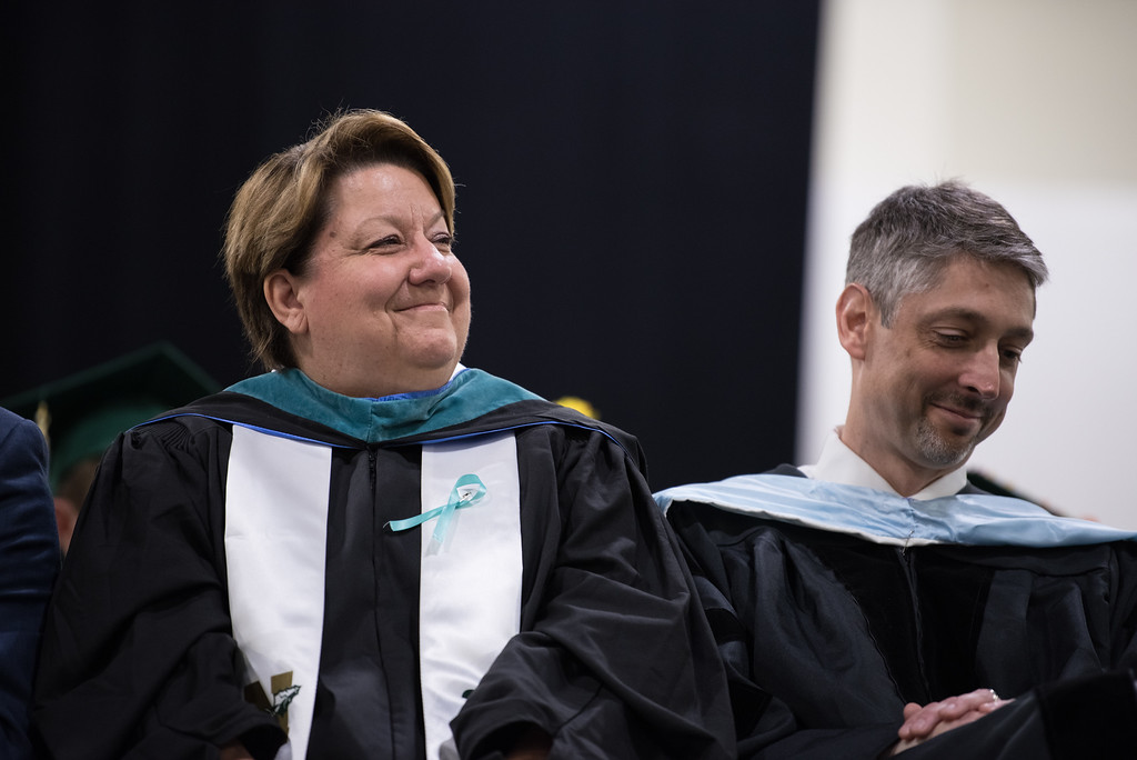 . School superintendent, Brooke Clenchy, and Nashoba Regional principal, Dr. Parry Graham smile, as they listen to student speakers during the Nashoba Regional High School Class of 2017 commencement ceremonies on Sunday Jun e11, 2017 at the DCU center in Worcester.  SENTINEL & ENTERPRISE/JEFF PORTER