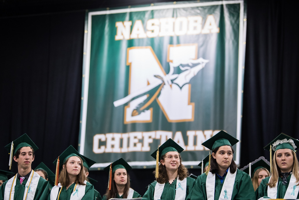 . A row of graduates listen to the valedictorians address during the Nashoba Regional High School Class of 2017 commencement ceremonies on Sunday Jun e11, 2017 at the DCU center in Worcester.  SENTINEL & ENTERPRISE/JEFF PORTER