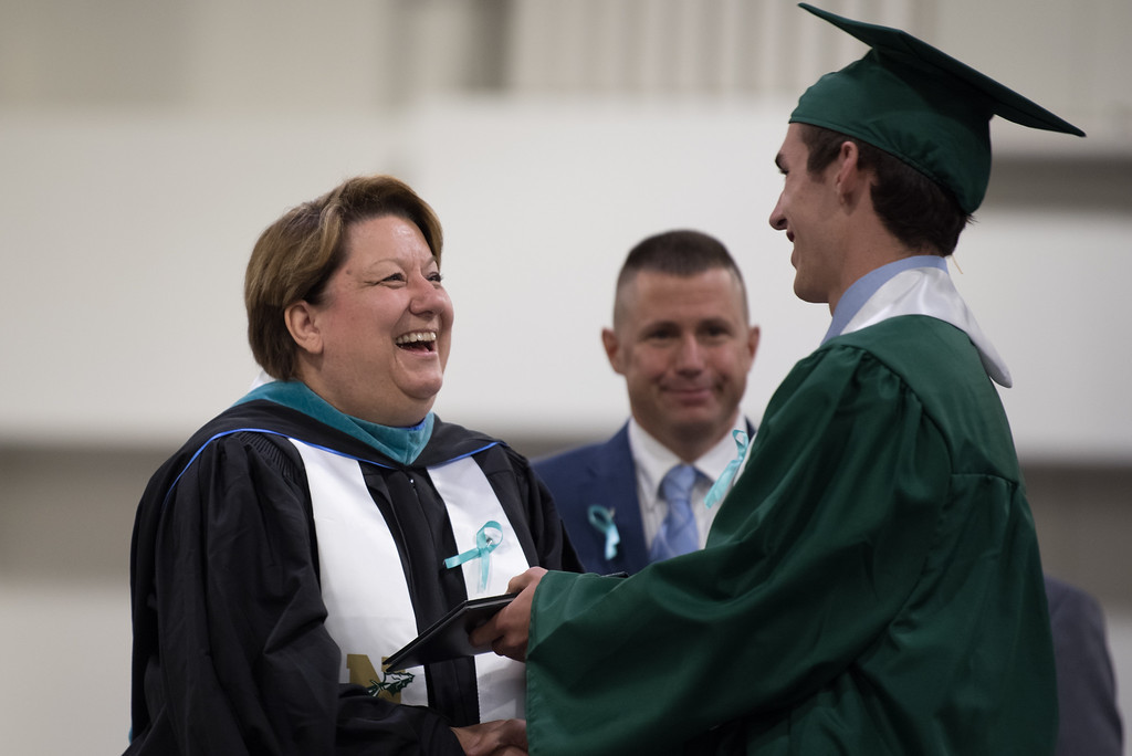 . Superintendent Brooke Clenchy (left) hands a diploma to graduate Greg Kane during the Nashoba Regional High School Class of 2017 commencement ceremonies on Sunday Jun e11, 2017 at the DCU center in Worcester.  SENTINEL & ENTERPRISE/JEFF PORTER