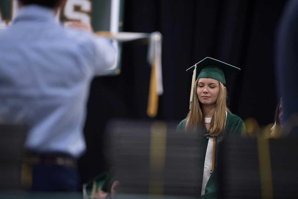 . Graduate Toni Day stands as her name is called to receive her diploma during the Nashoba Regional High School Class of 2017 commencement ceremonies on Sunday Jun e11, 2017 at the DCU center in Worcester.  SENTINEL & ENTERPRISE/JEFF PORTER