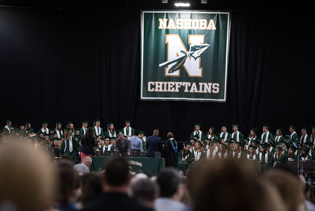 . A large audience watches as graduates cross the main stage to receive their diplomas during the Nashoba Regional High School Class of 2017 commencement ceremonies on Sunday Jun e11, 2017 at the DCU center in Worcester.  SENTINEL & ENTERPRISE/JEFF PORTER