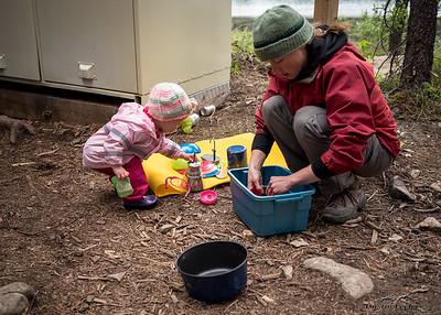 Helping as always. Everyone has camp chores in the backcountry, no free rides at 18 months of age  ;)