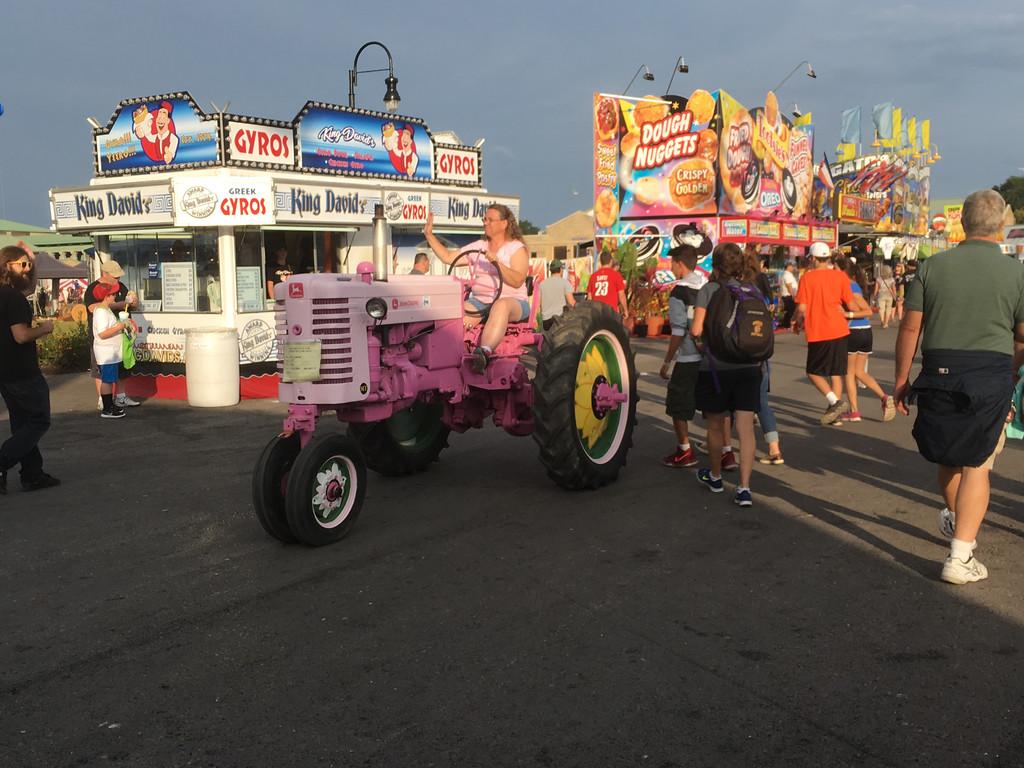 . Karen Alvord - Oneida Daily Dispatch Fair goers enjoy the Great New York State Fair in Geddes on Monday, Aug. 28, 2017.